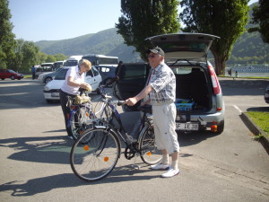 A_couple_on_a_cycling_trek_on_banks_of_Rhine_River(Germany)